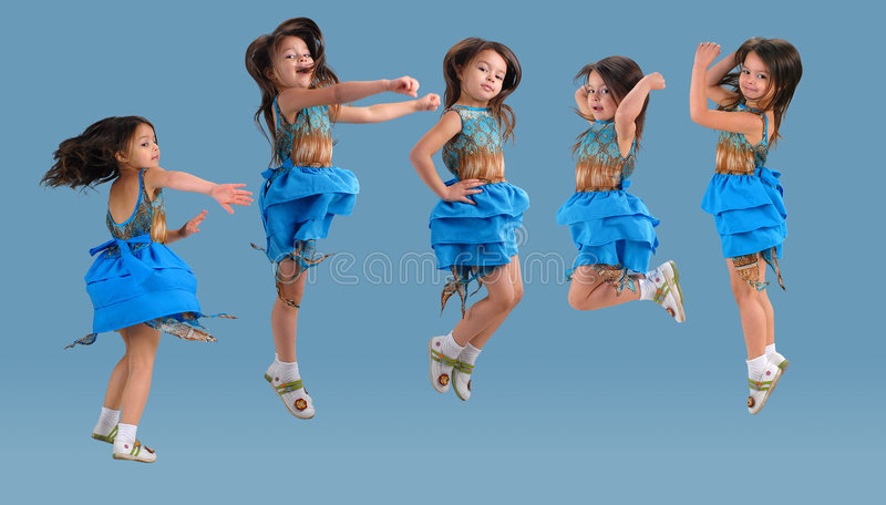 Cute little jumping girl royalty free stock photos