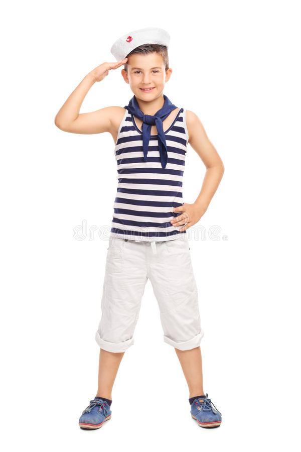Cute little kid in a sailor uniform saluting. Full length portrait of a cute little kid in a sailor uniform saluting towards the camera isolated on white stock images