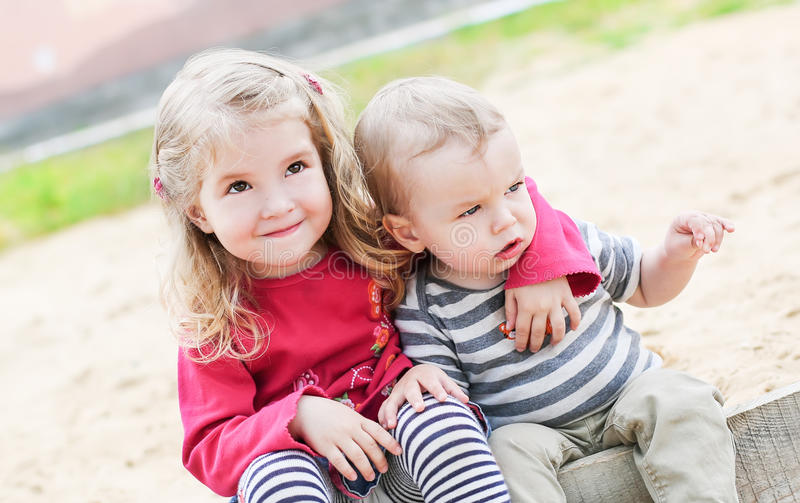 Cute little kids hugging royalty free stock image