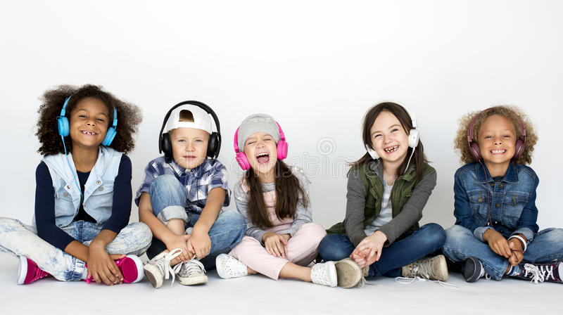 Cute Little Kids Sitting Listening to Music royalty free stock photography