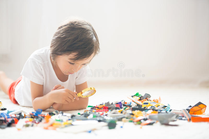 Cute little preschool children, boy brothers, playing at home wi stock photo