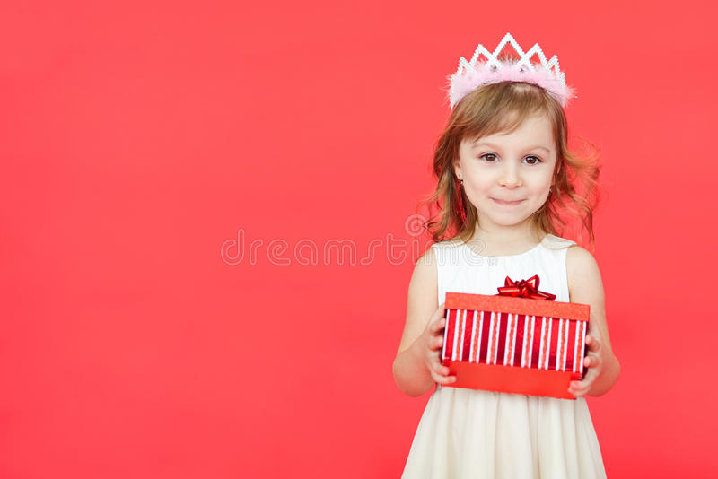 Cute little preschooler girl christmas portrait, isolated on red royalty free stock photography