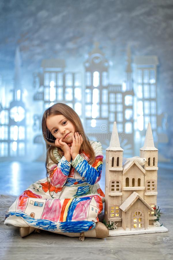 Cute little princess at ice castle studio decoration royalty free stock photo