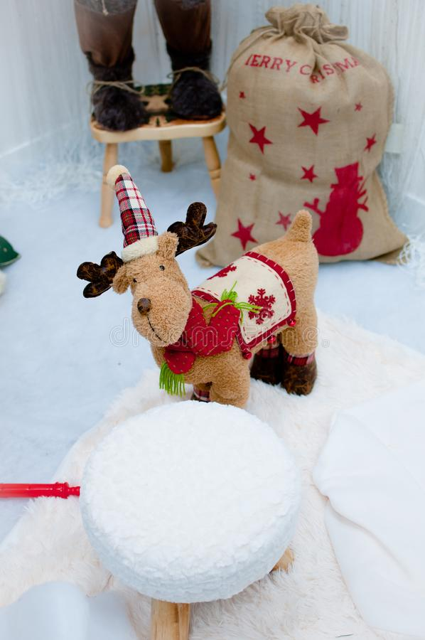 Cute little reindeer santa. With hat, Christmas decoration royalty free stock photos