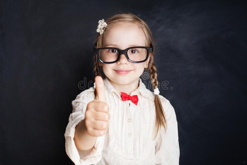 Cute Little School Girl Pupil Showing Thumb Up stock photo