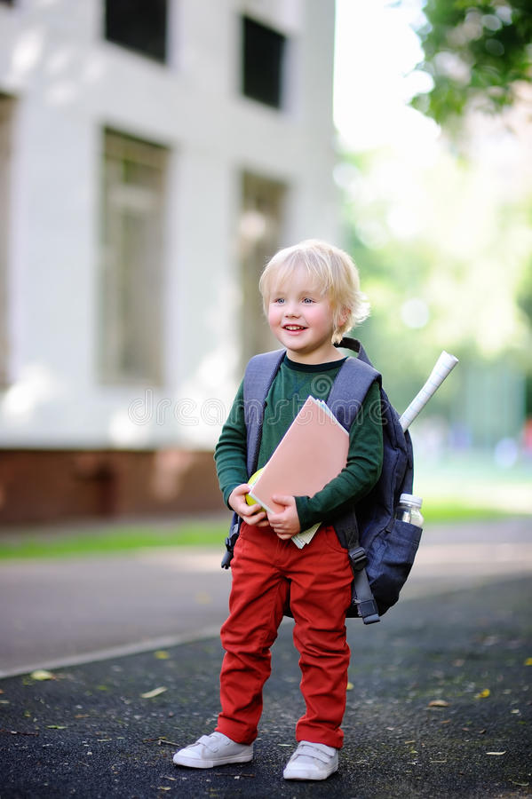 Cute little schoolboy with his backpack. Back to school concept. royalty free stock image