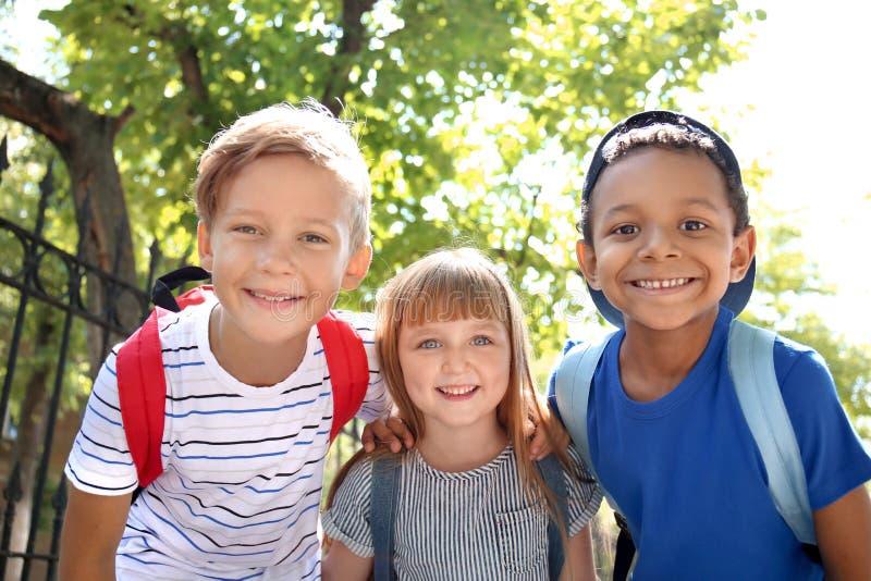 Cute little schoolchildren outdoors stock photography