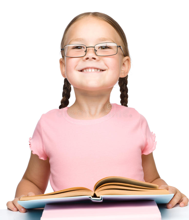 Cute little schoolgirl with a book royalty free stock photo