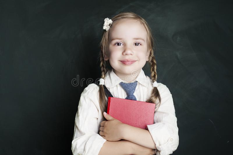 Cute little schoolgirl child with school book royalty free stock photos