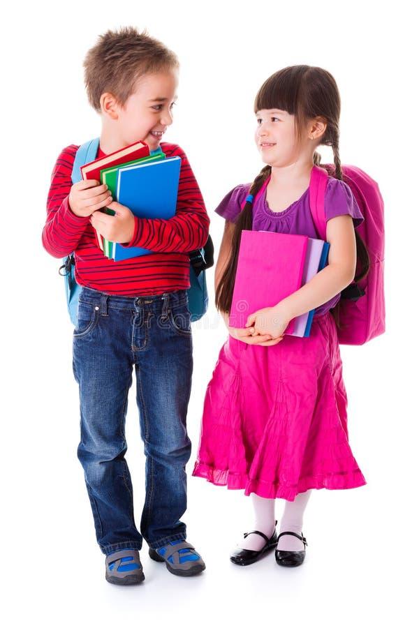 Cute little schoolgirl and schoolboy stock image