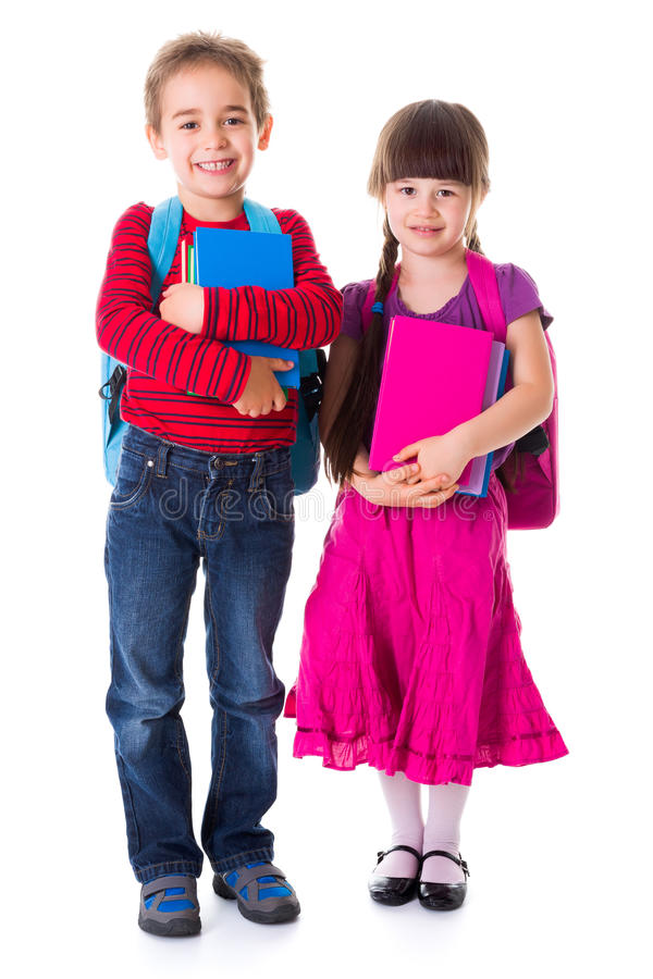 Cute little schoolgirl and schoolboy royalty free stock photos