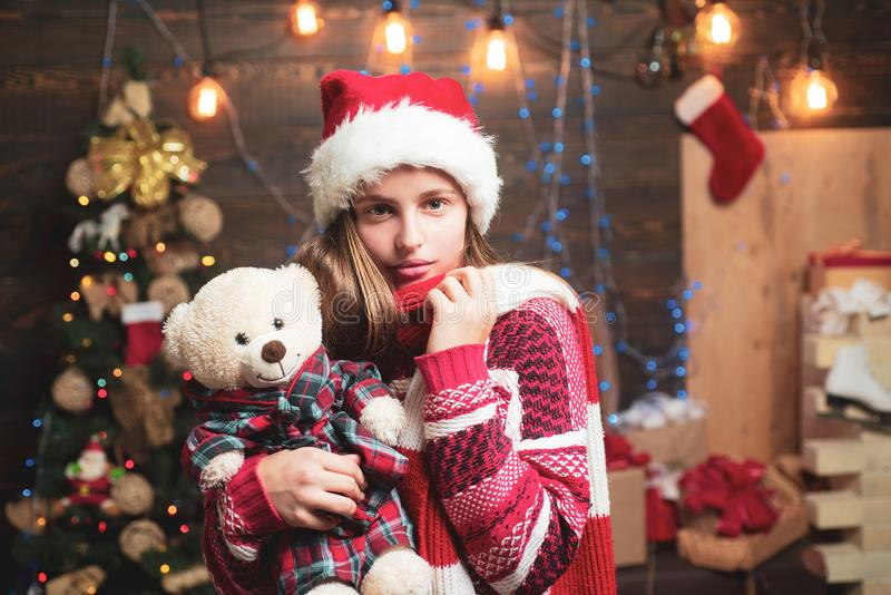 Cute little teenager celebrating Christmas. Joyful teenager looking at camera in Christmas at home. Opening gifts on. Christmas and New Year royalty free stock photography