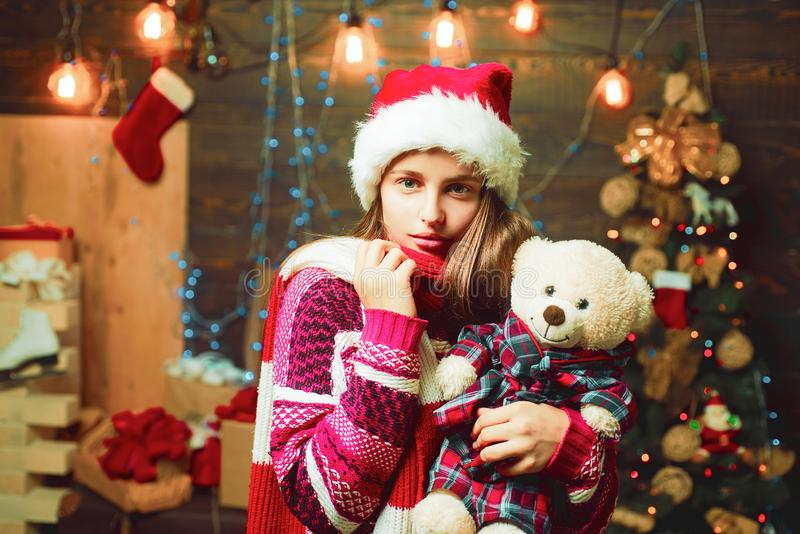 Cute little teenager celebrating Christmas. Joyful teenager looking at camera in Christmas at home. Opening gifts on. Christmas and New Year royalty free stock image