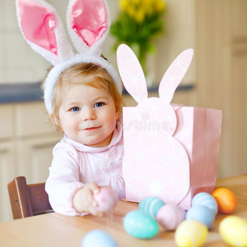 Free Cute Little Toddler Girl Wearing Easter Bunny Ears Playing With Colored Pastel Eggs. Happy Baby Child Unpacking Gifts Royalty Free Stock Photography - 169210947