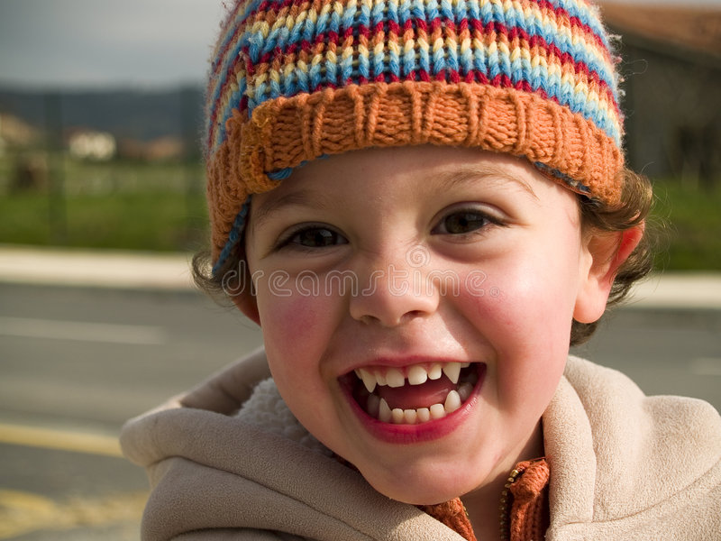 Cute little vampire boy smiling