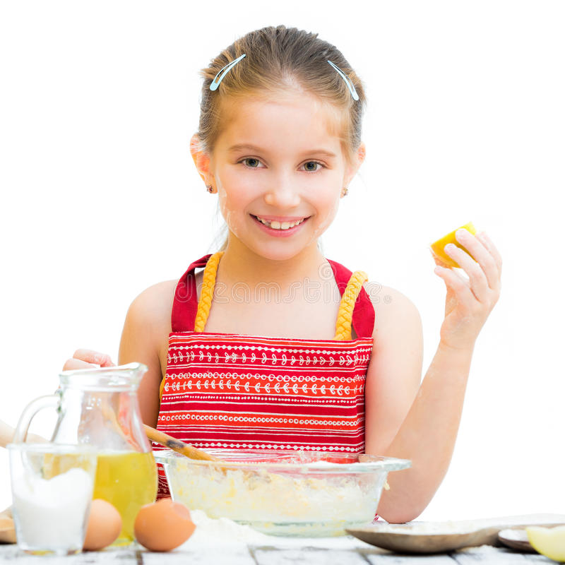 Cute llittle girl cooking. Cakes isolated on a white background royalty free stock photography