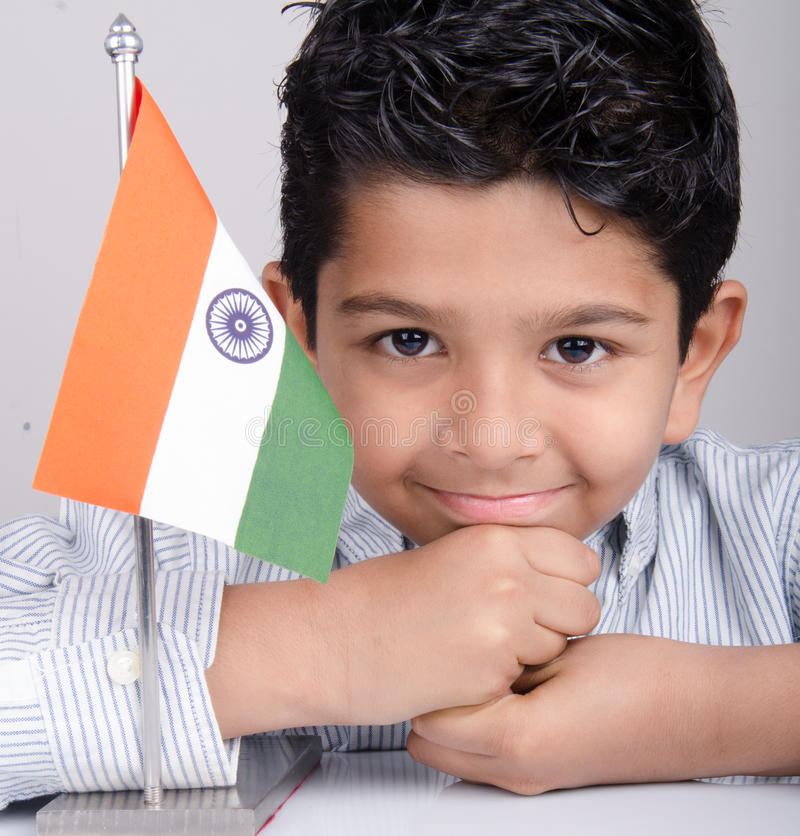 Cute looking indian kid with indian flag.  stock image