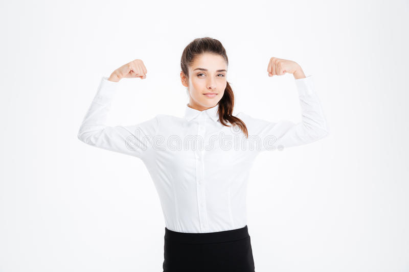 Cute lovely young businesswoman showing biceps royalty free stock photos