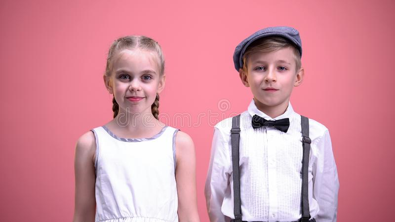 Cute male and female children smiling on camera Saint Valentines day celebration stock images