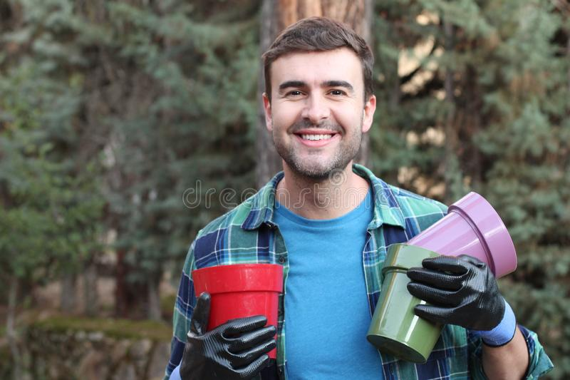 Cute man working on his garden royalty free stock photos