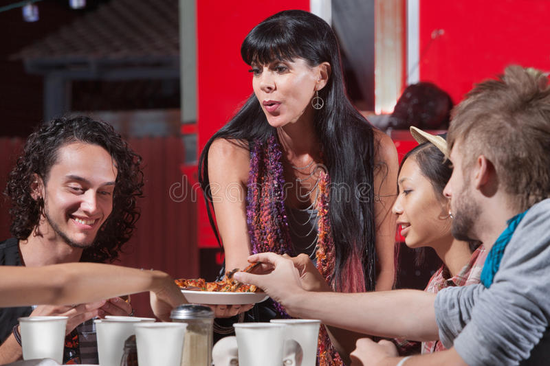 Mature Woman Serving Pizza stock image