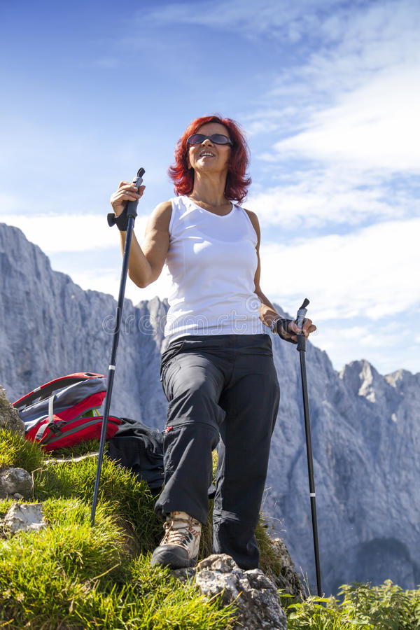 Cute middle aged female hiker resting royalty free stock photos
