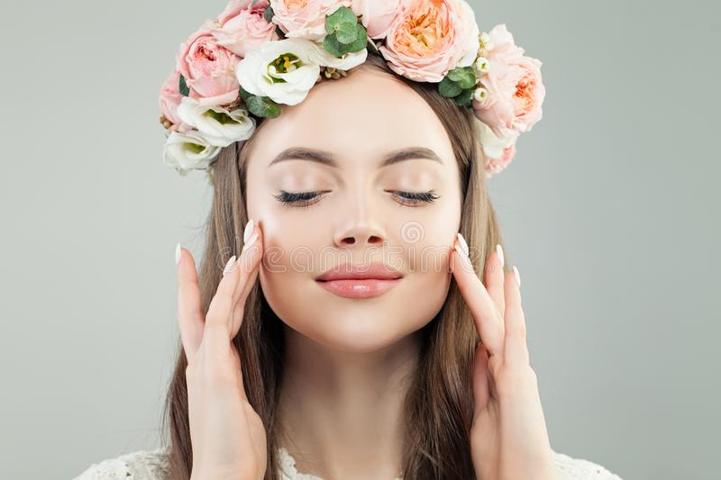 Cute Model Woman Face. Natural Makeup and Flowers, Skincare and Facial Treatment Concept.  stock image