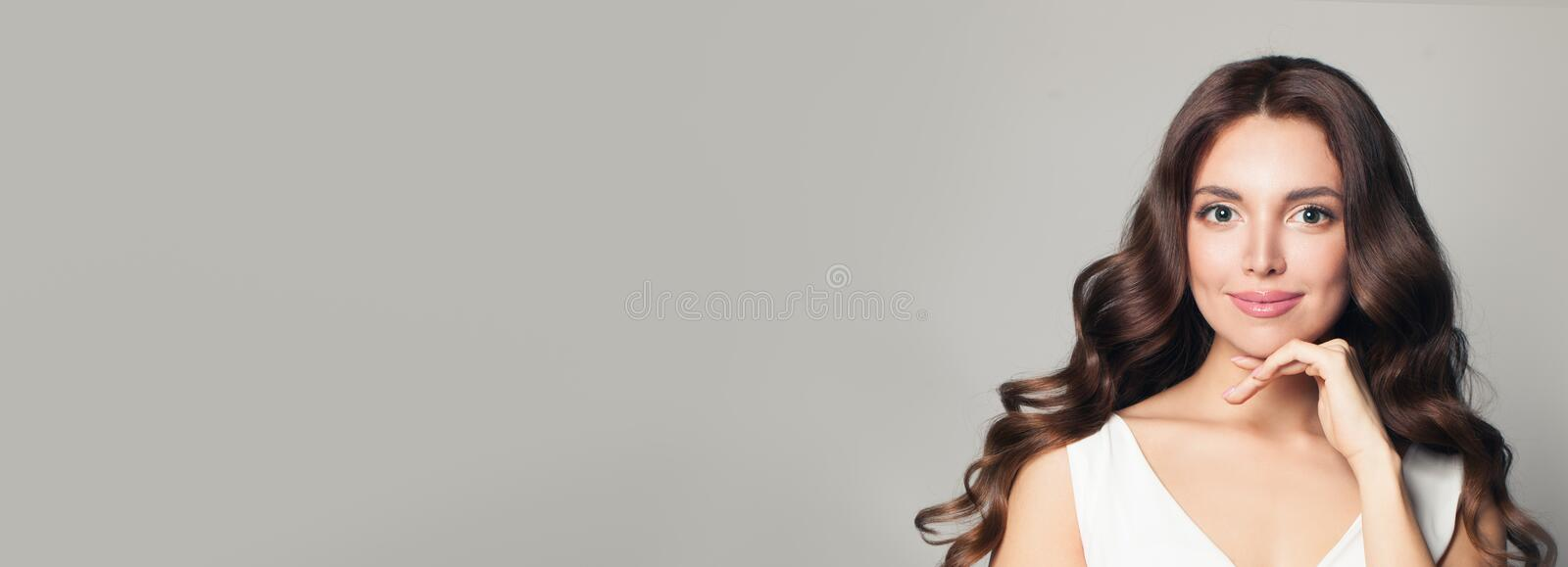 Cute model woman with long curly hair on banner background royalty free stock images