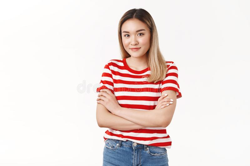 Cute modest asian blong teenage girl sighing watching distance classmate feel sympathy cross fingers chest smiling royalty free stock photos