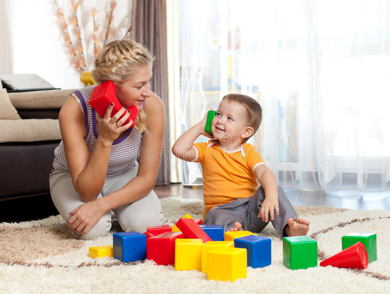 Download Cute Mother And Kid Boy Playing Together Stock Photo - Image: 24858846