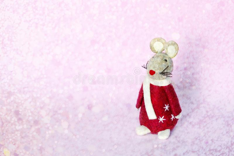 Cute mouse toy on blurred christmas background with lights bokeh. Xmas rat is symbol of New year 2020 according to Chinese royalty free stock images