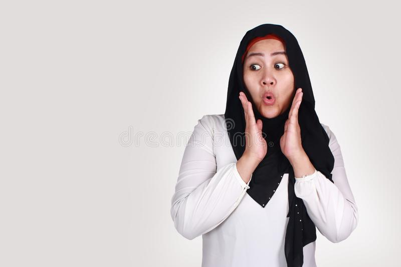 Cute Muslim Lady Shows Shocked Surprised Face with Open Mouth,Looking to the Side stock images