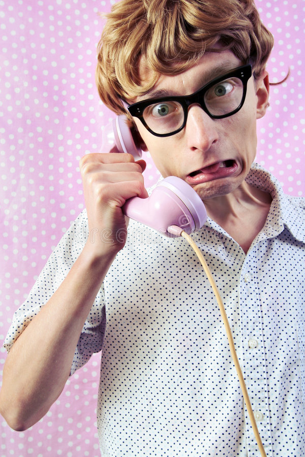 Cute nerd. Disgust on the phone, pink background royalty free stock images
