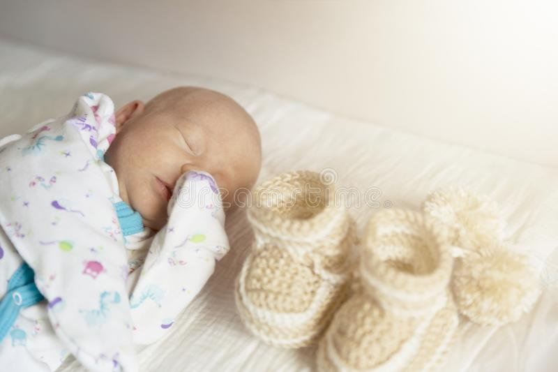 Cute newborn baby boy sleeps in a nursery while changing diapers royalty free stock image