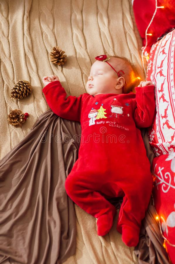 Cute newborn baby in a Christmas costume on a bed at home royalty free stock photography
