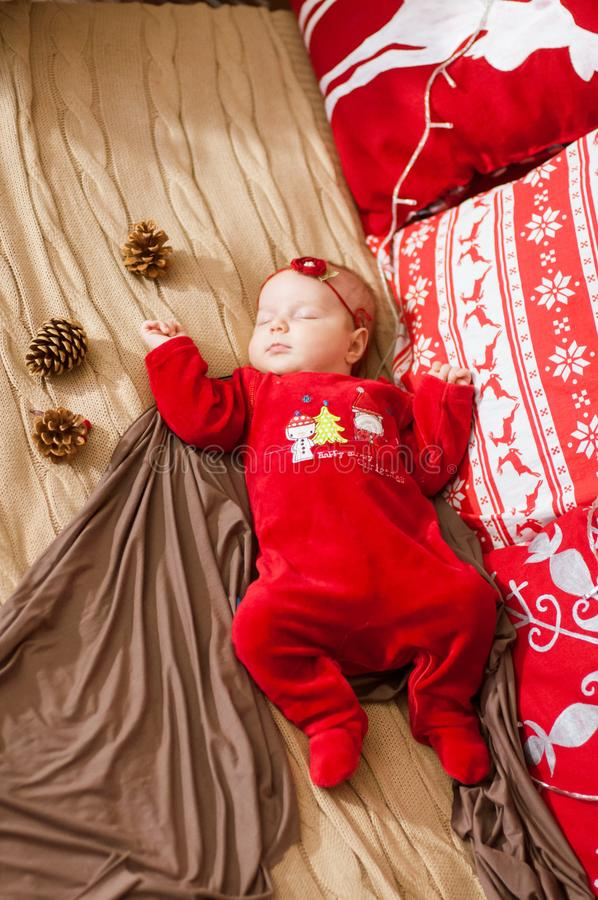 Cute newborn baby in a Christmas costume on a bed at home royalty free stock photos