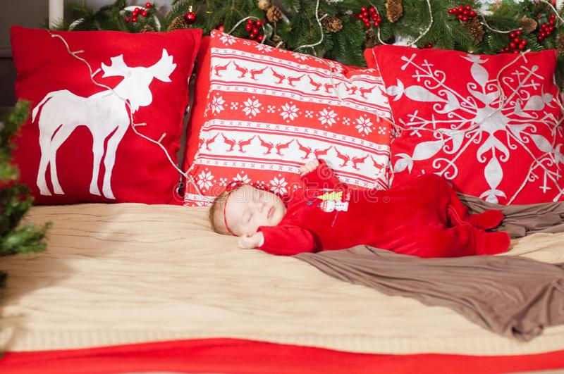 Cute newborn baby in a Christmas costume on a bed at home royalty free stock image