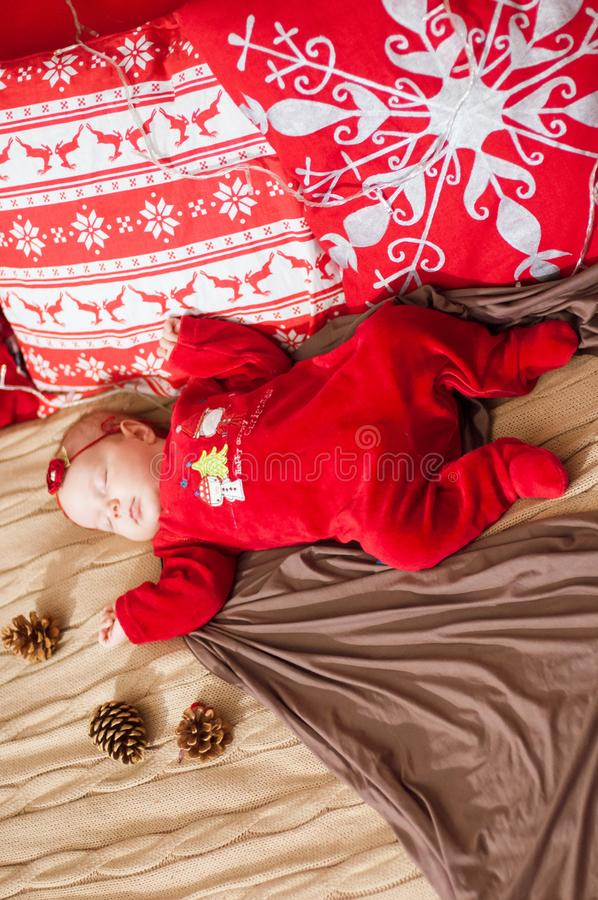 Cute newborn baby in a Christmas costume on a wooden bed royalty free stock images