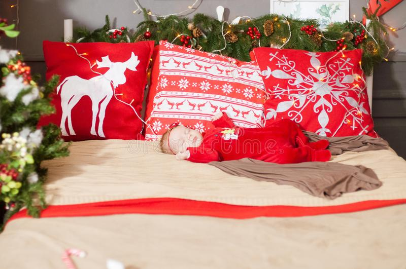 Cute newborn baby in a Christmas costume on a wooden bed stock image