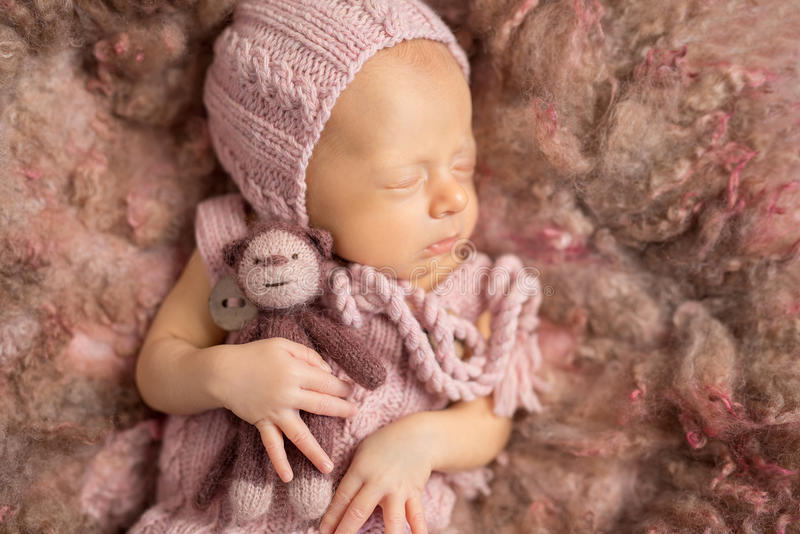 Cute newborn baby on fluffy blanket in hat and suit royalty free stock photos
