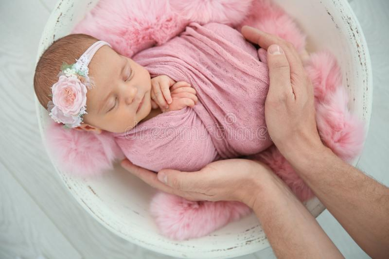 Cute newborn baby girl with her father on light background royalty free stock photo