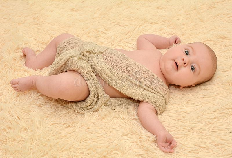 Cute newborn baby lies royalty free stock photos