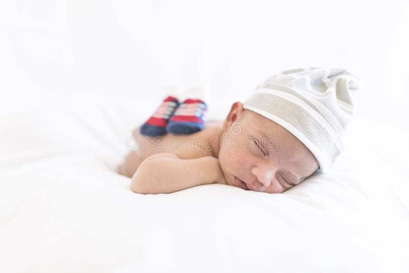 A cute newborn baby sleeping on his tummy royalty free stock photos
