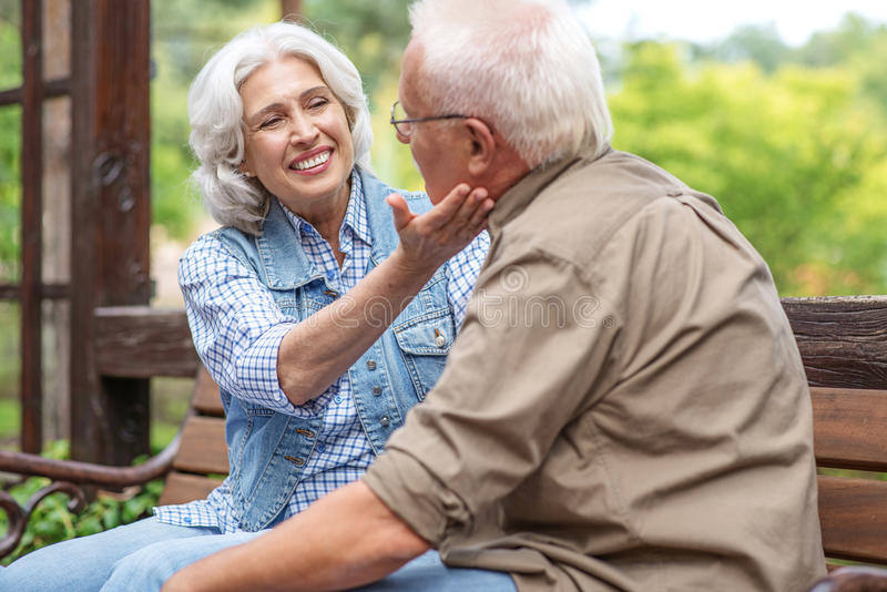 cute old lovers sitting on bench stock photo - image of female