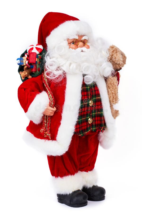 Cute old Santa Claus doll with gifts. stock photography