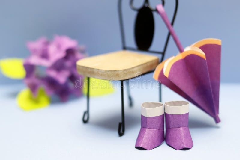 Cute origami rain goods, umbrella and boots stock photos