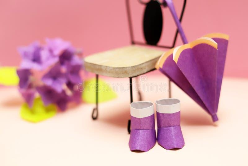Cute origami rain goods, umbrella and boots royalty free stock photo