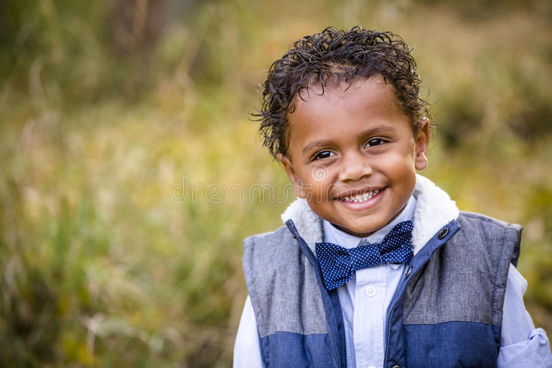Cute outdoor portrait of a smiling African American young boy stock photos