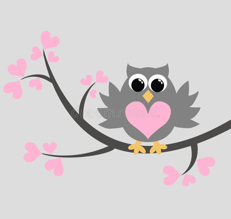 a cute owl sitting on a branch royalty free stock images