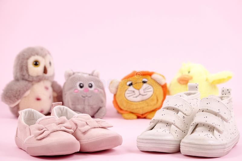 Cute picture with small children`s shoes with stuffed animal royalty free stock image